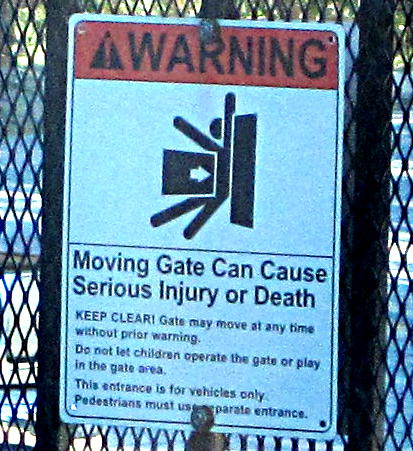 [Moving gate can cause serious injury or death]