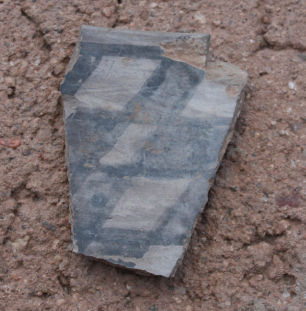 [Pot sherd we found in the yard]