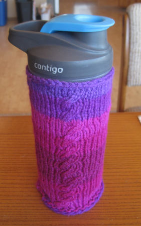 [knitted water bottle cozy with cables]