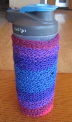 [First, messy knit water bottle cozy]