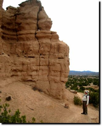 [Ken inspects a Nambe Badlands formation]