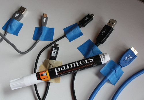 [USB cables painted for orientation]
