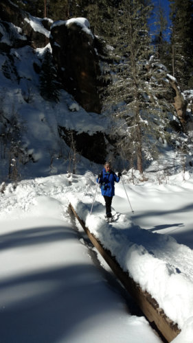 [Akk on snowshoes crossing the Jemez East Fork]